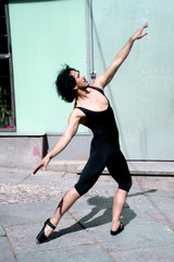 Dancer with black leotard and ballet tips