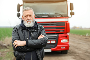 Portrait of mature driver at modern truck outdoors Fototapete