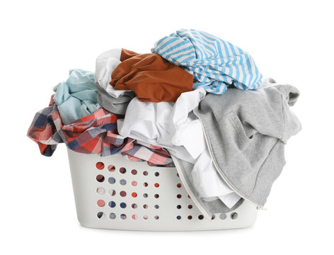 Basket full of dirty laundry isolated on white