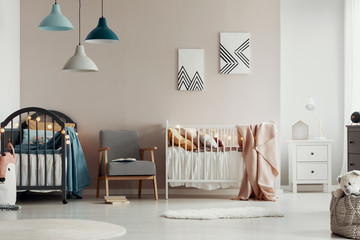 Stylish kid's bedroom interior with elegant wooden furniture and posters on the wall