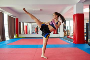 Kickboxer girl shadow boxing