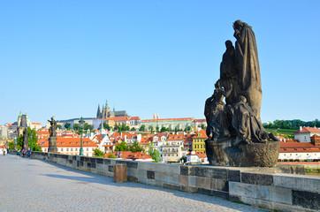 Papiers peints Prague Famous Charles Bridge in Prague, Czech Republic with historical statues. In background historical center of the city with dominant Prague Castle. Amazing cities. Praga, Czechia. Czech capital