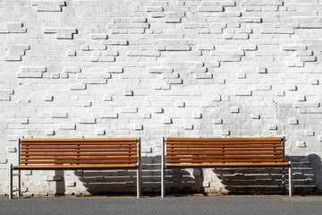 park bench with white brick wall isolated