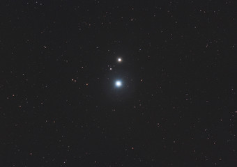 Closeup of double star Mizar and Alcor in Ursa Major  constellation, with many stars as background in the deep space.