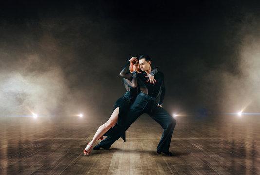 Elegant dancers, ballrom dance on theatre stage