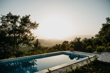 Swimming pool with panoramic views of the sunset or dawn