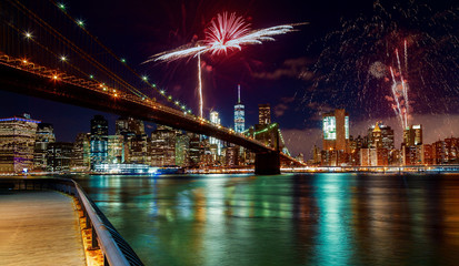 Brooklyn Bridge at dusk in New York City Colorful and vibrant fireworks