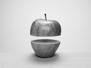 Apple cut in half with top floating above bottom