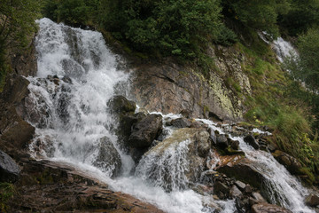 Closeup view waterfall scene in mountains, national park of Dombay, Caucasus