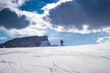 Ski tourer in the alps ascending