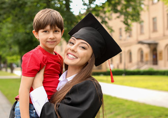 Woman with little son on her graduation day
