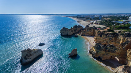Aerial. View of the Portuguese beaches Prainha Tres Irmaos. Portimao