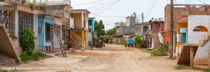 Panoramic Street View of a small Cuban Town during a vibrant sunny day. Taken in Trinidad, Cuba. Wall mural