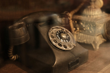 collectibles and decoration - Classic and old telephone reciever. retro technology. vintage color...