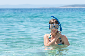 Woman with snorkeling mask dive in the sea Wall mural