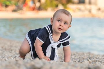 Cute little baby girl on the beach