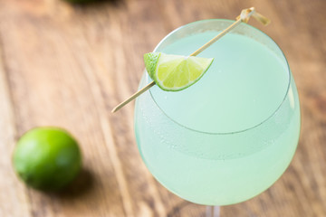 Refreshing green cocktail, summer drink with lime in a glass