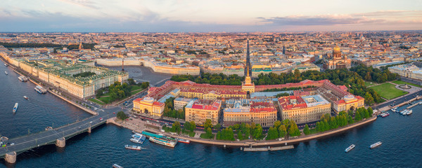 Panoramic sunset view of the historical center of St. Petersburg, the Hermitage Winter Palace, the Palace Square, the Admiralty, St. Isaac's Cathedral and the Bronze Horseman Peter 1.
