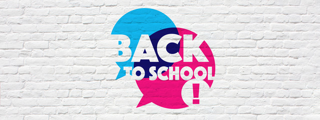 Back to school on speech bubble, on brick wall background