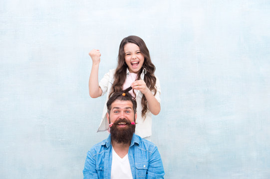 Change hairstyle. Create funny hairstyle. Child making hairstyle styling father beard. Being parent means present for kid interests. With healthy dose of openness any dad can excel at raising girl