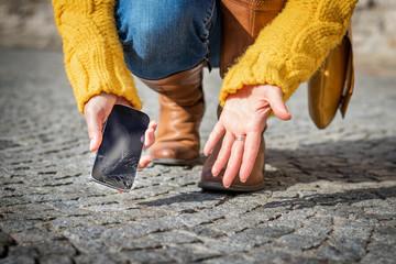 Woman feeling frustration from broken smartphone