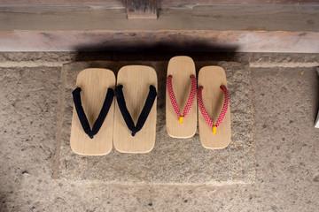 Japanese traditional sandals of man & woman 古民家の玄関に置かれた男女の下駄