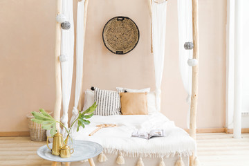 interior room made in white and beige colors in the style of boho