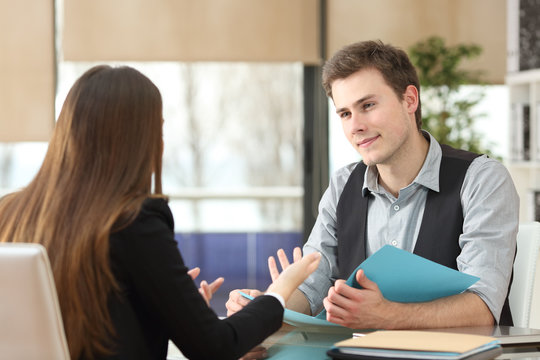 Businessman and woman having an interview at office
