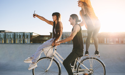 Friends on bike posing for a selfie