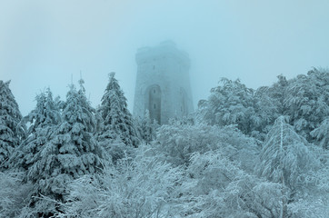 Memorial of Liberty Shipka, Gabrovo, Bulgaria - December 31, 2018. The Shipka symbolizes Bulgaria's struggle for freedom from Turkish slavery. Winter picture, fog, deep snow, trees covered with snow.