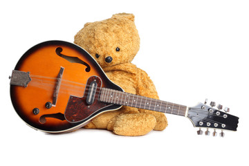Wall Mural - Country style teddy bear and mandolin on white background