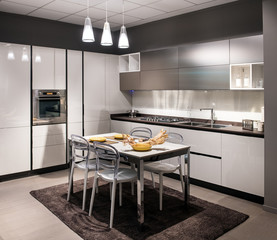 Modern luxury fitted kitchen with center table
