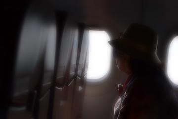 soft focus of older women on the plane.