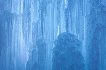An abstract frozen waterfall with blue and white ice and beautiful details in winter Fototapete