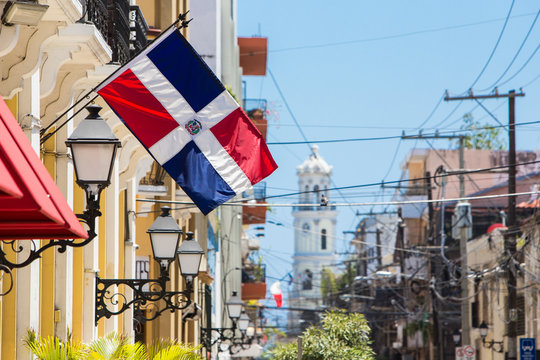 Arzobispo Merino street. Santo domingo. Flag of the Dominican Republic on the wall of a building in the colonial zone