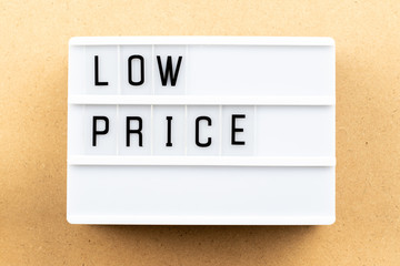 Light box with word low price on wood background