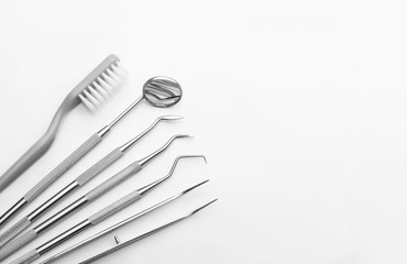 Wall Mural - Dental tools on white background. Medical technology concept. Dental hygiene. Cure concept. Dentist tools. Dental equipment.