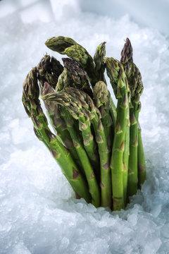 Asparagus stalks on ice. Close-up.