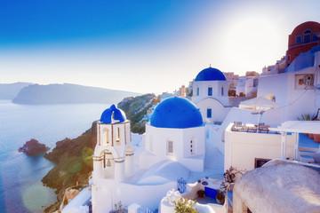 Spoed Foto op Canvas Santorini Santorini, Greece. Charming view Oia village on Santorini island. Traditional famous blue dome church over the Caldera in Aegean sea. Traditional blue and white Cyclades architecture.