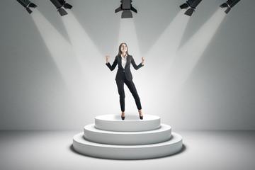 Attractive businesswoman on podium