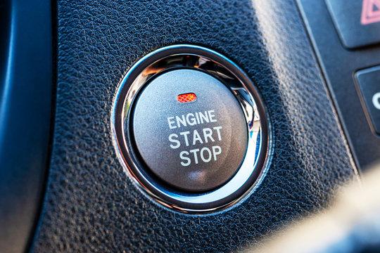 luxury start stop engine button at premium car. automobile push power switch.