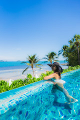 Portrait beautiful young asian woman relax in luxury outdoor swimming pool in hotel resort nearly...