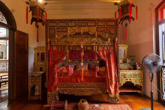 Traditional Chinese bedroom interior of the Pinang Peranakan Mansion in Penang, Malaysia