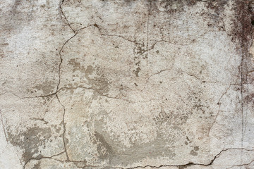 Texture of a concrete wall with cracks and scratches which can be used as a background Wall mural