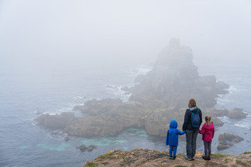 Family admiring landscape of the Lands End Wall mural