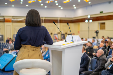 Female speaker at business conference
