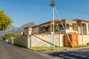 House with fences with Table Mountain view in the idyllic Claremont in Cape Town, South Africa.