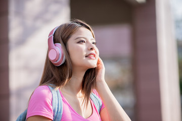 student listen music with phone