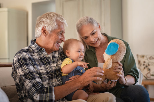 Grandparents playing with grandson