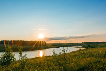 Fototapete - Sunset on the lake. Beautiful peaceful landscape